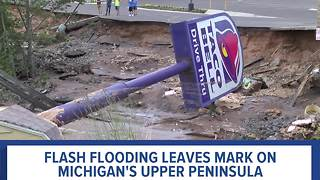 Flash flooding washes out roads in Michigan's upper peninsula - Video