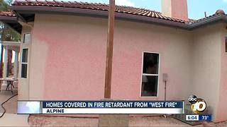 Homes covered in fire retardant from West Fire - Video