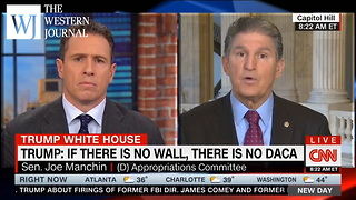 Watch: CNN's Chris Cuomo Does Not Look Happy When Sen. Joe Manchin Says 'We Need A Wall' - Video
