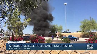 Armored vehicle rolls over, catches fire
