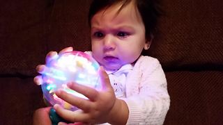 """""""Little Girl Dazzled By Spinning Ball Of Light"""""""
