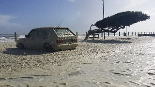 Promenade Covered in Foam as Storm Swells Hit Cape Town Coast - Video