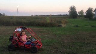 A Girl Drives A Go-Cart And Crashes Into A Cornfield