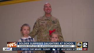 Soldier surprises daughters in school for Veteran's Day Assembly - Video