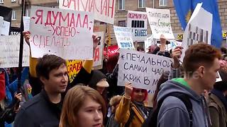 Absurdist 'Monstration' rally sweeps through Russian city - Video