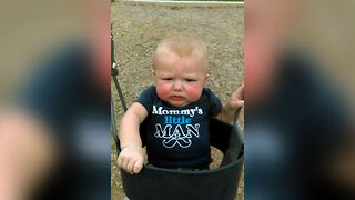 Baby Makes Hilarious Face While Swinging