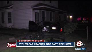 Stolen car crashes into multiple homes, bursts into flames after police chase