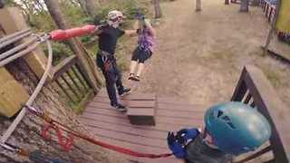 Family Enjoys Some Zip Line Fun - Video