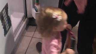 Twin toddlers help daddy unpack the groceries