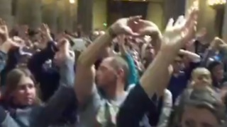 Tourists Hold Hands in Air During Lockdown Inside Notre Dame Cathedral - Video