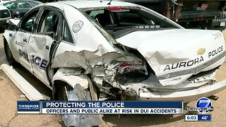 Aurora officers narrowly avoid being hit by suspected drunk driver