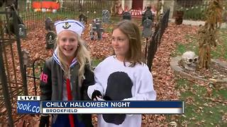 Trick-or-treaters bundle up for chilly Halloween - Video