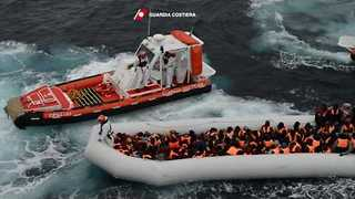 Italian Coast Guard Reassures Migrants Drifting at Sea - Video