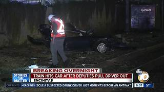 Train hits car after driver pulled out by deputies - Video