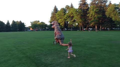 Here's a sight you don't normally see: T-Rex steals little girl's bike!