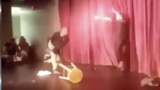 Man Jumps Stage During Comedian Segment And Throws Blows - Video