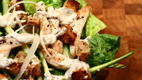 Healthy chicken Caesar salad with Parmesan and mustard dressing