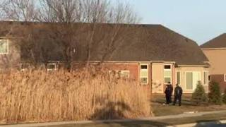 Police investigating after woman found shot in Warren - Video
