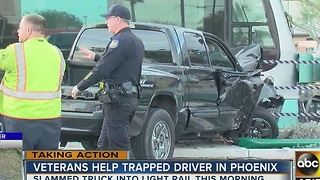 Veterans help driver trapped after crash with light rail - Video