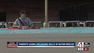 Parents learn life-saving skills in water rescue - Video