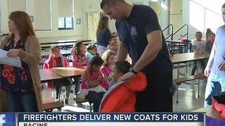 Racine elementary students get free coats from Operation Warm - Video