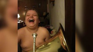 Boy Scares Brother With Tuba - Video