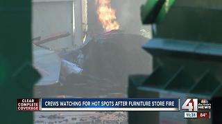 Crews begin investigation into three-alarm fire at furniture warehouse - Video