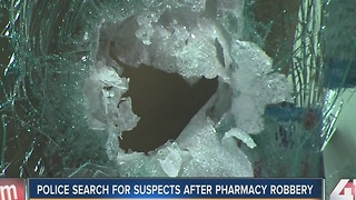 Police search for suspects after pharmacy robbery - Video