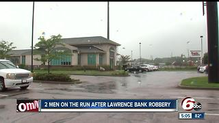 Two men on the run after robbing Lawrence bank, $10K reward offered for their arrest - Video
