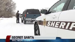 Malhuer County Sheriff Deputies hand out cash thanks to Secret Santa