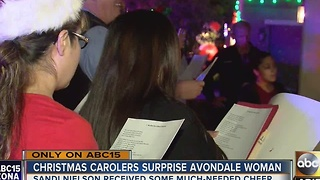 Woman surprised with Christmas carolers in Avondale