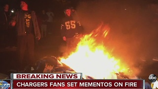 Chargers fans set mementos on fire - Video