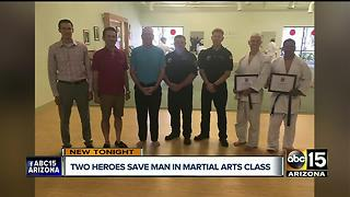 Men save man suffering heart attack during martial arts class - Video