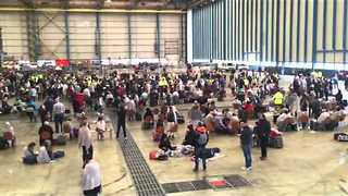 Hundreds Wait in Brussels Airport Hangar Following Blasts - Video