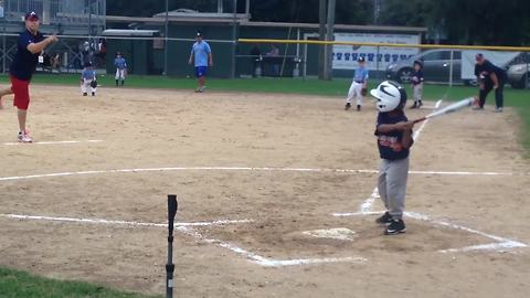 A Tot Boy Falls And Flips Over After Hitting A Tee Ball