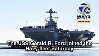 Trump helps commission $12.9B aircraft carrier USS Gerald R Ford - Video