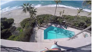 A Kid Jumps Off A Six-Storey Balcony Into A Pool - Video