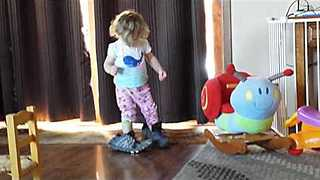 Little Girl Stomps Around in Massive Shoes