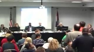 Officer tackles college professor during debate - Video