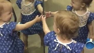 Adorable Baby Girl Showers Her Own Mirror Reflection With Kisses
