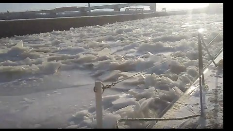 Tow Boat Struggles Through Thick Mississippi River Ice Near Clarksville