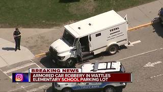 Police investigating armored truck robbery at elementary school in Troy - Video