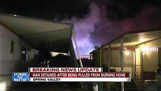 Man rescued from burning Spring Valley home - Video