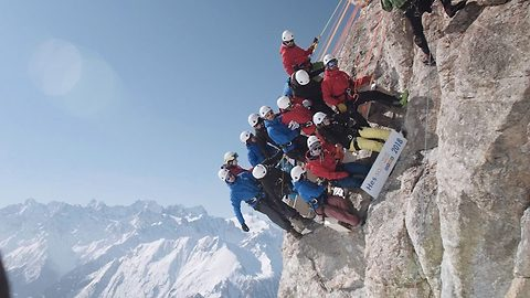 World's coolest (and highest) class photo: Students rappel down cliff face to take class photo on mountain