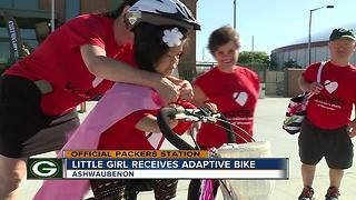 Wisconsin girl receives adaptive bike - Video