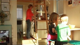 Mother moves family into tiny (260-square-foot) home after husband's death