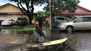 People 'Surf' Through Flooded South Florida Streets - Video