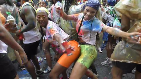 Thousands turn out for Notting Hill Carnival in London despite heavy rain