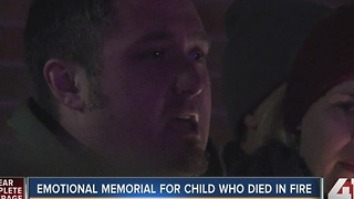 Emotional memorial for child who died in fire - Video