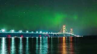 Glorious Northern Lights Seen Dancing in Timelapse Shot over Michigan's Mackinac Bridge - Video